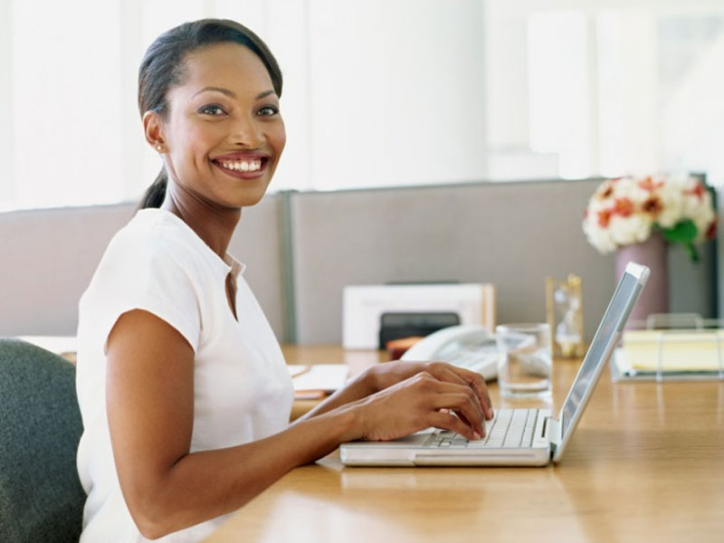 woman using laptop at desk